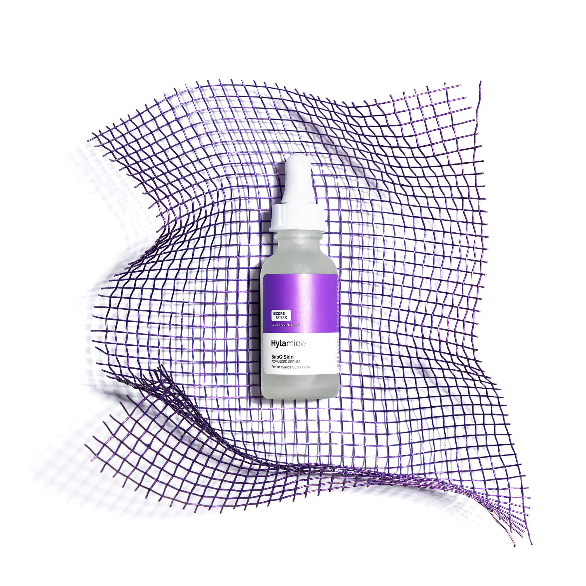 Hylamide SubQ Skin serum bottle against purple netting
